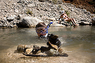 Melissa Pierson Cherry and her nephew Taylor brown (in the water) comes at the weekend to the East Fork River in California to look for gold.Saturday August 1/2008