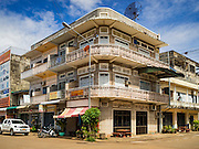 16 JUNE 2016 - PAKSE, CHAMPASAK, LAOS: Typical shophouse buildings on a street in Pakse. Pakse is the capital of Champasak province in southern Laos. It sits at the confluence of the Xe Don and Mekong Rivers. It's the gateway city to 4,000 Islands, near the border of Cambodia and the coffee growing highlands of southern Laos.      PHOTO BY JACK KURTZ