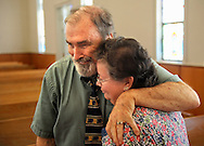 13 MAY 2012 -- FESTUS, Mo. -- The Rev Bill Charlton (left) embraces church member Terry Bates after the final church service at the First Presbyterian Church in Festus Sunday, May 13, 2012. The congregation is merging with nearby Grace Presbyterian Church in neighboring Crystal City. Photo © copyright 2012 Sid Hastings.