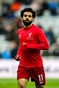 Mohamed Salah (#11) of Liverpool warms up ahead of the Premier League match between Newcastle United and Liverpool at St. James's Park, Newcastle, England on 4 May 2019.