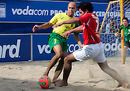 07 December 2006, Brazil's Sidney Souto and England's Giancarlo Giancovich fight for possetion of the ball during the first game of the Vodacom Pro Beach Soccer Tour at Durban's Bay of Plenty on Thursday. Brazil won the game 10 - 3. Picture: Shayne Robinson, PhotoWire Africa