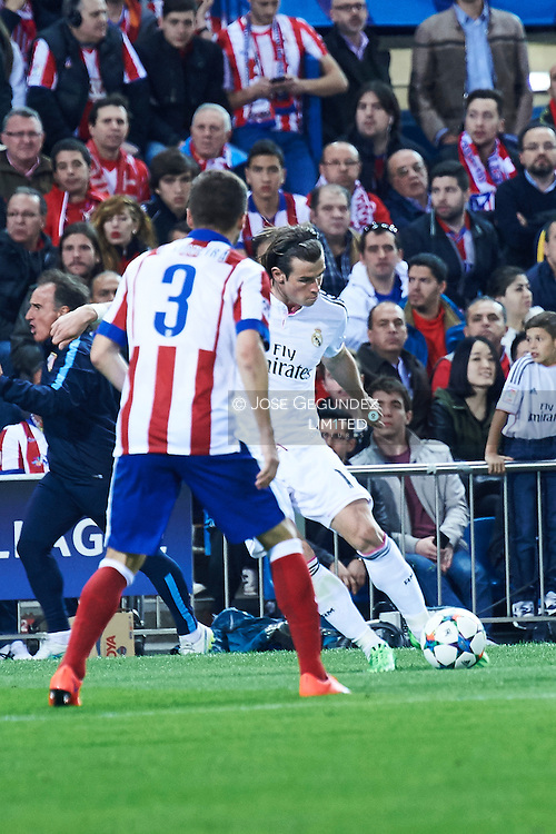 Siqueira and Gareth Bale in action during the Champions League, round of 4 match between Atletico de Madrid and Real Madrid at Estadio Vicente Calderon on April 14, 2015 in Madrid, Spain
