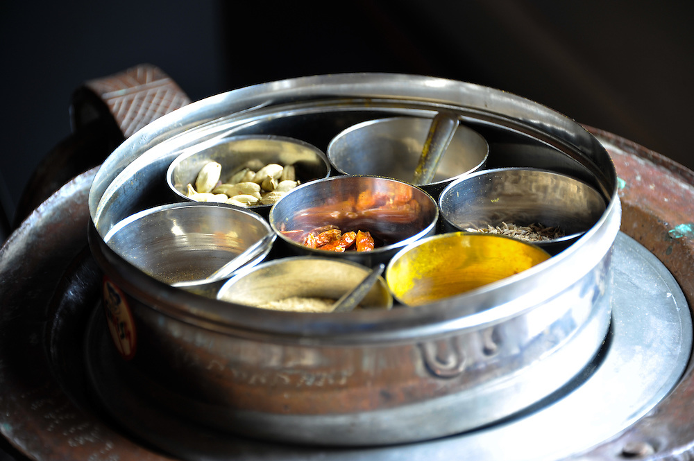 Most Indian homes have at least 1 Masala Dabba, used to store the most commonly used spices. A Masala Dabba is a traditional Indian spice box set made up of one large outer tin with two lids and 7 inner spice pots filled with commonly used spices.