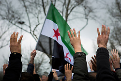 People rally at Sarchane park in Istanbul, Turkey, to mark the 4th anniversary of the Syrian Civil War.