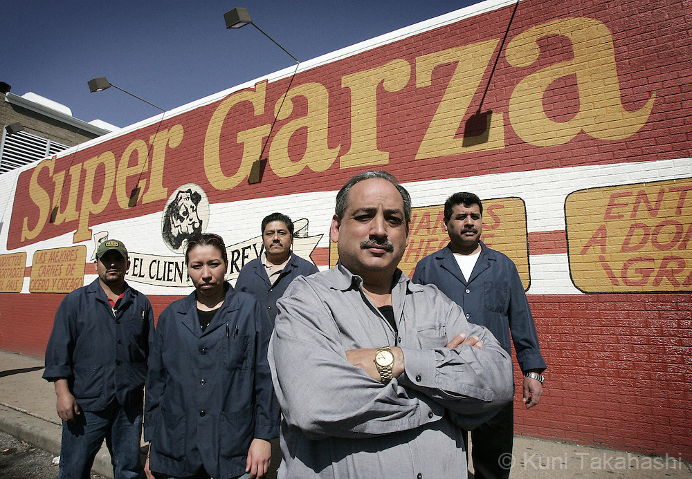 Roberto Garza, owner of Super Garza supermarket, poses with his employees at the store in Cicero, IL. (Photo by Kuni Takahashi)