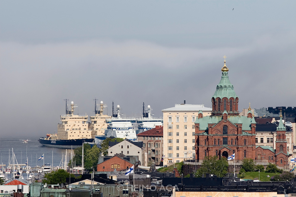 Panoramic view from Bar Ateljee at Sokos Hotel Torni, a famous art deco highriser. The six ice breakers keeping the baltic ice-free in winter moored in their summer quarters behind Uspenski Orthodox cathedral.