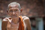 Skinny old Buddhist monk in Luang Prabang (Laos)