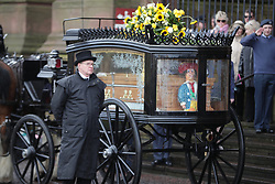 © Licensed to London News Pictures. 28/03/2018. Liverpool, UK. The horse drawn cortege arrives at Liverpool Cathedral . The funeral of comedian and performer Sir Ken Dodd , who died on 11th March 2018 at the age of 90 . Photo credit: Joel Goodman/LNP