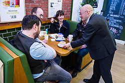 Pictured: Patrick Harvie keen to serve the people.<br /> <br /> Greens co-cordinator Partrick Harvie headed to Rose Street in Edinburgh today to serve customers at Social Bite cafe, a social enterprise supporting the homeless<br /> <br /> Ger Harley | EEm 20 April 2016
