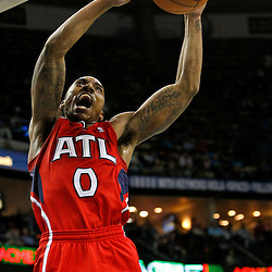 January 29, 2012; New Orleans, LA, USA; Atlanta Hawks point guard Jeff Teague (0) dunks against the New Orleans Hornets during the second half of a game at the New Orleans Arena. The Hawks defeated the Hornets 94-72.  Mandatory Credit: Derick E. Hingle-US PRESSWIRE