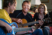 02 SEPTEMBER 2004 - PHOENIX, AZ:  CAL CAMPBELL, (left) and his father,  music legend GLEN CAMPBELL and Glen's wife (Cal's mother) KIM CAMPBELL in the Campbell home in the Biltmore section of Phoenix, AZ.   PHOTO BY JACK KURTZ