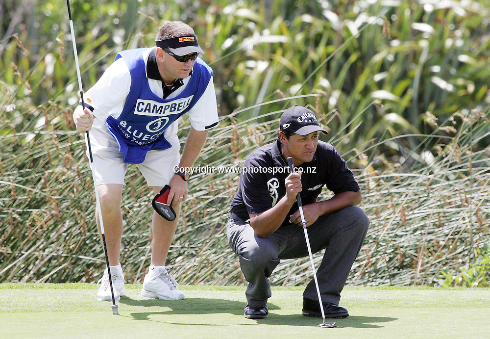 Michael Campbell (NZL) eyes his putt up with his caddy Andrew Knight on day two of the Blue Chip New Zealand Golf Open at Gulf Harbour, Whangaparoa, New Zealand on Friday 1 December 2006. Photo: Hannah Johnston/PHOTOSPORT<br /> <br /> <br /> <br /> 011206