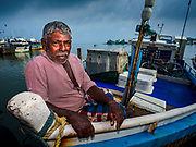 08 OCTOBER 2017 - NEGOMBO, WESTERN PROVINCE, SRI LANKA: A man on his fishing boat in Negombo, north of Colombo. Fish is an important source of protein for many Sri Lankans.    PHOTO BY JACK KURTZ