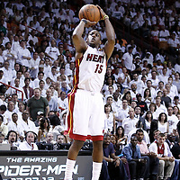 19 June 2012: Miami Heat point guard Mario Chalmers (15) takes a three points jumpshot during the third quarter of Game 4 of the 2012 NBA Finals, Thunder at Heat, at the AmericanAirlinesArena, Miami, Florida, USA.