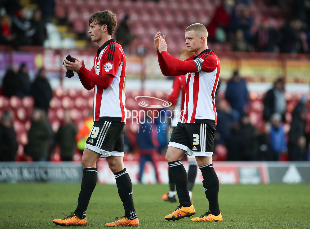 Brentford defender, Jake Bidwell (3) and Brentford midfielder, John Swift (19) applauding fans after loss during the Sky Bet Championship match between Brentford and Charlton Athletic at Griffin Park, London, England on 5 March 2016. Photo by Matthew Redman.