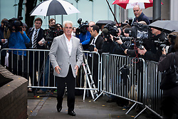 © London News Pictures. 04/10/2013. London, UK.  Publicist Max Clifford leaving Southwark Crown Court in London where he pleaded not guilty to 11 counts of indecent assault allegedly committed between 1966 and 1985 relating to seven alleged victims, ranging in age from 14 to 19. Photo credit: Ben Cawthra/LNP