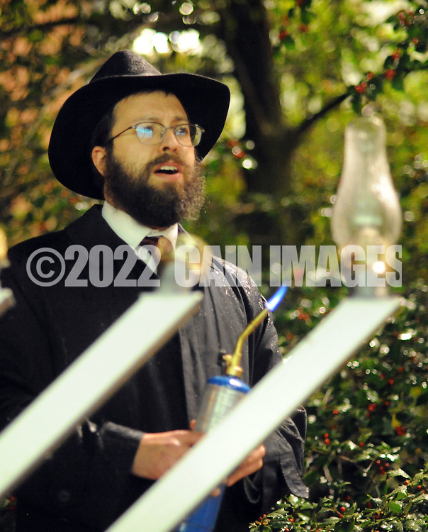 "DOYLESTOWN, PA - DECEMBER 16: Rabbi Mendel Prus of the Lubavitch of Doylestown speaks to the crowd before lighting a menorah during a Hanukkah  celebration at the Bucks County Courthouse December 16, 2014 in Doylestown, Pennsylvania. After the lighting of the menorah, the group continued the celebration of the ""festival of lights"" inside the courthouse. (Photo by William Thomas Cain/Cain Images)"