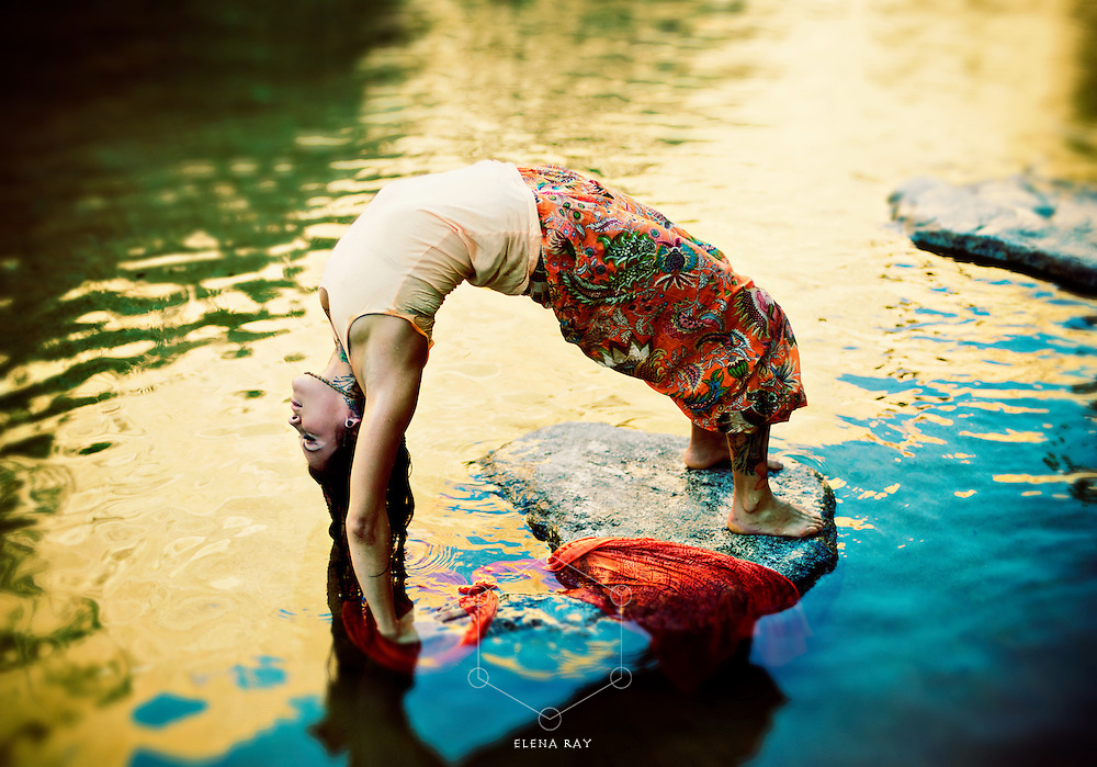 Yoga Woman outdoors in yoga pose urdhva dhanurasana in a colorful pond.<br /> :::<br /> &quot;All fluid activities are in resonance. They mutualize and inform each other. The fluid inside this biosphere called Earth and the fluids of our bodies are in constant rapport.&quot;<br /> &mdash;Emilie Conrad