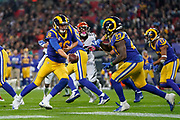LA Rams Quarterback Jared Goff (16) hands off to LA Rams Running Back Darrell Henderson (27) during the International Series match between Los Angeles Rams and Cincinnati Bengals at Wembley Stadium, London, England on 27 October 2019.