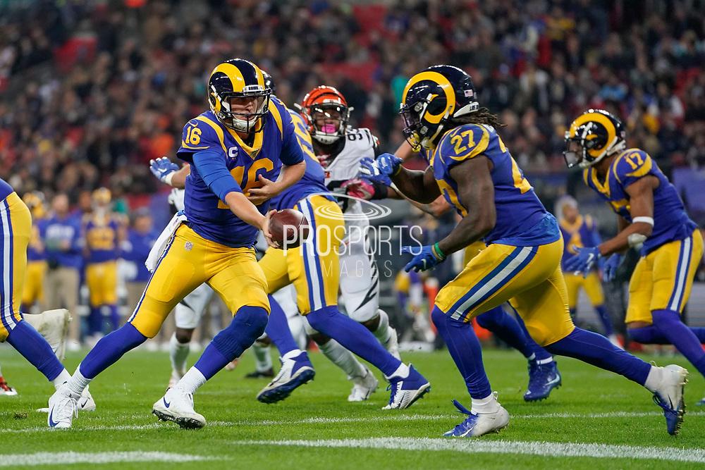 LA Rams Quarterback Jared Goff (16) hands off to LA Rams Running Back Darrell Henderson (27) during the International Series match between Los Angeles Rams and Cincinnati Bengals at Wembley Stadium, London, England on 27 October 2019.