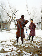Archer wearing traditional dress (with decidedly non-traditional bow.) Archery is Bhutan's national sport.