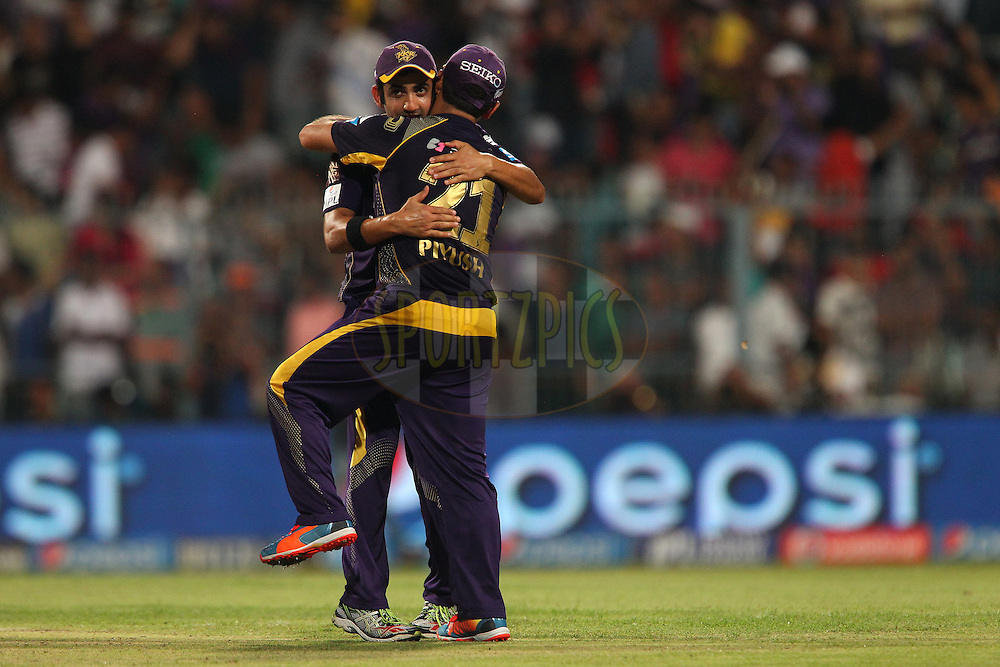 Gautam Gambhir captain of the Kolkata Knight Riders and Piyush Chawla of the Kolkata Knight Riders celebrate the win during the first qualifier match (QF1) of the Pepsi Indian Premier League Season 2014 between the Kings XI Punjab and the Kolkata Knight Riders held at the Eden Gardens Cricket Stadium, Kolkata, India on the 28th May  2014<br /> <br /> Photo by Ron Gaunt / IPL / SPORTZPICS<br /> <br /> <br /> <br /> Image use subject to terms and conditions which can be found here:  http://sportzpics.photoshelter.com/gallery/Pepsi-IPL-Image-terms-and-conditions/G00004VW1IVJ.gB0/C0000TScjhBM6ikg