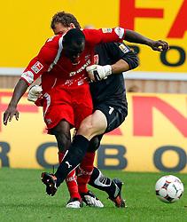 Jens Lehmann (VfB) takes  Manasseh Ishiaku from behind. VfB Stuttgart v FC Köln, in der Mercedes Benz Arena Stuttgart, 19th September 2009.