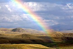 Rainbow over central Colorado ranch land.