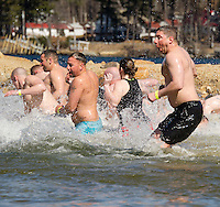 Not a balmy day at the beach for members of the Laconia and Sanbornton Police Departments as they enter the lake for the 8th annual Winni Dip for Special Olympics at Margate Beach on Saturday.  (Karen Bobotas/for the Laconia Daily Sun)