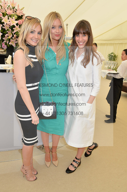 Left to right, JOANNE FROGGATT, LAURA WHITMORE and LAURA JACKSON at the St.Regis International Polo Cup at Cowdray Park, Midhurst, West Sussex on 16th May 2015.