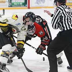 "TRENTON, ON  - MAY 5,  2017: Canadian Junior Hockey League, Central Canadian Jr. ""A"" Championship. The Dudley Hewitt Cup. Game 7 between Georgetown Raiders and the Powassan Voodoos. Josh Dickinson #28 of the Georgetown Raiders and  Parker Bowman #17 of the Powassan Voodoos at the face-off during the third period.<br /> (Photo by Tim Bates / OJHL Images)"