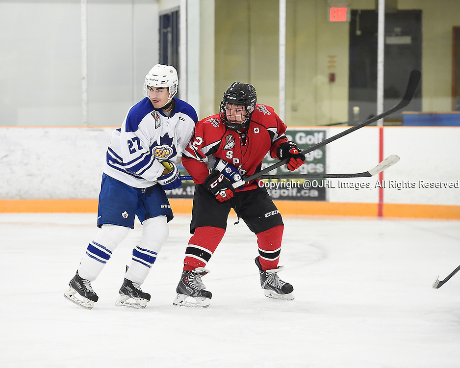 STOUFFVILLE, ON - Oct 3, 2015 : Ontario Junior Hockey League game action between Markham and Stouffville, Riley St. Onge #27 of the Markham Royals battles for control with Jack Varga #2 of the Cobourg Cougars during the second period.<br /> (Photo by Andy Corneau / OJHL Images)