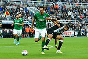 Lewis Dunk (#5) of Brighton & Hove Albion steps in to steal the ball away from Joelinton (#9) of Newcastle United during the Premier League match between Newcastle United and Brighton and Hove Albion at St. James's Park, Newcastle, England on 21 September 2019.