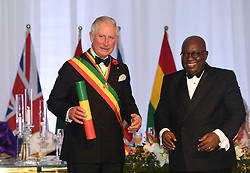 The Prince of Wales is made a Companion of the Order of the Star of Ghana by Ghanaian President Nana Akufo-Addo during a State Dinner at Jubilee House, in Accra, Ghana, on day six of the royal trip to west Africa.