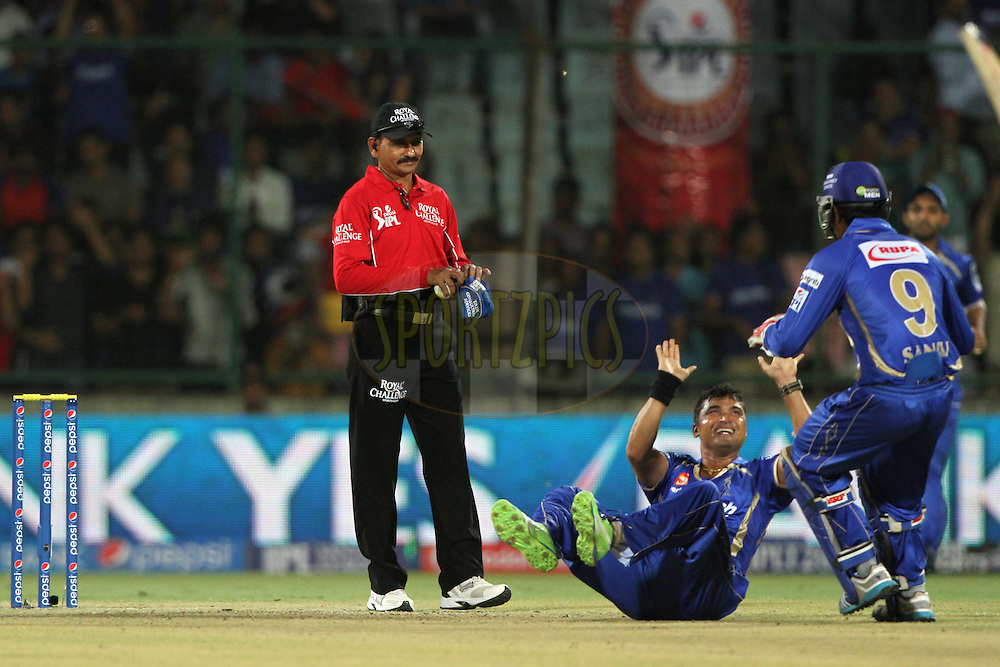 Pravin Tambe of the Rajatshan Royals celebrates the wicket of Quinton de Kock of the Delhi Daredevils during match 23 of the Pepsi Indian Premier League Season 2014 between the Delhi Daredevils and the Rajasthan Royals held at the Feroze Shah Kotla cricket stadium, Delhi, India on the 3rd May  2014<br /> <br /> Photo by Deepak Malik / IPL / SPORTZPICS<br /> <br /> <br /> <br /> Image use subject to terms and conditions which can be found here:  http://sportzpics.photoshelter.com/gallery/Pepsi-IPL-Image-terms-and-conditions/G00004VW1IVJ.gB0/C0000TScjhBM6ikg