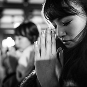 TOKYO, JAPAN - JANUARY 3 : A woman pray at Sensoji Buddhist temple at the Asakusa district in Tokyo to offer New Year prayers on Tuesday, January 3, 2017. (Photo by Richard Atrero de Guzman/NURPhoto)