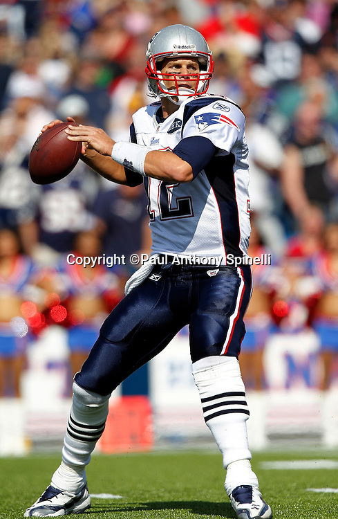 New England Patriots quarterback Tom Brady (12) throws a pass during the NFL week 3 football game against the Buffalo Bills on Sunday, September 25, 2011 in Orchard Park, New York. The Bills won the game 34-31. ©Paul Anthony Spinelli
