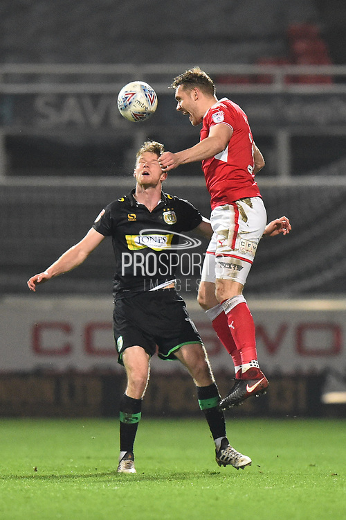 Chris Hussey (3) of Swindon Town leaps above Alex Fisher (18) of Yeovil Town to head the ball during the EFL Sky Bet League 2 match between Swindon Town and Yeovil Town at the County Ground, Swindon, England on 10 April 2018. Picture by Graham Hunt.