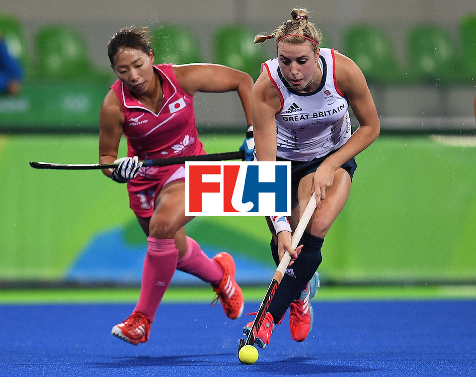 Britain's Lily Owsley (R) controls the ball as Japan's Yukari Mano chases during the women's field hockey Japan vs Britain match of the Rio 2016 Olympics Games at the Olympic Hockey Centre in Rio de Janeiro on August, 11 2016. / AFP / MANAN VATSYAYANA        (Photo credit should read MANAN VATSYAYANA/AFP/Getty Images)