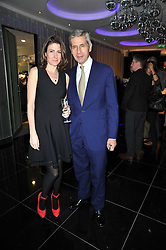 DOLLY JONES editor of Vogue.com and SIR STUART ROSE at a party to celebrate the 15th birthday of Vogue.com held at W Hotel, Leicester Square, London W1 on 17th February 2011.