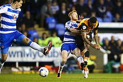 Abel Hernandez of Hull City shoots while tackled by Stephen Quinn of Reading - Mandatory byline: Jason Brown/JMP - 07966 386802 - 19/04/2016 - FOOTBALL - Madejski Stadium - Reading, England - Reading v Hull City - Sky Bet Championship