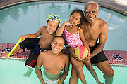 Grandfather with Grandchildren in Pool