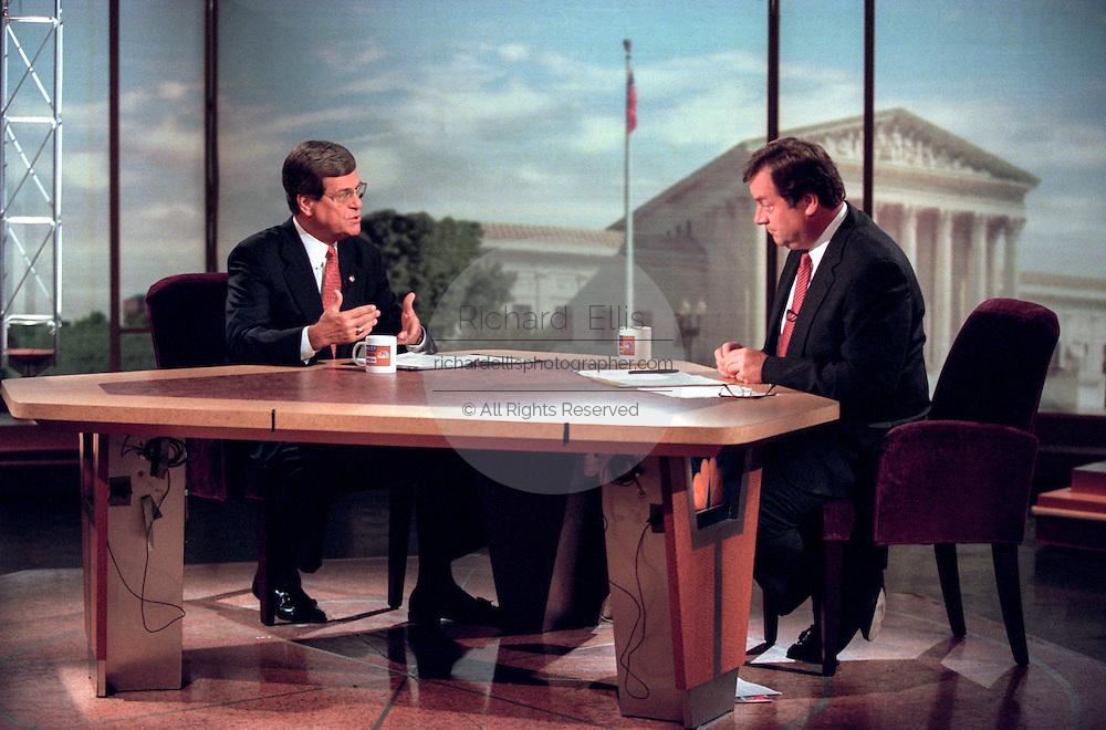 Host Tim Russert talks with Senate Majority Leader Trent Lott during NBC's Meet the Press September 6, 1998 in Washington, DC.