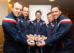 © Licensed to London News Pictures. 25/02/2014. London, UK. Team GB men's curling team pose with their medals at the Sofitel Hotel at Heathrow Airport on 24th February 2014. Photo credit : Vickie Flores/LNP