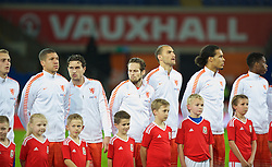 CARDIFF, WALES - Friday, November 13, 2015: Wales mascots with the the Netherlands team before the International Friendly match at the Cardiff City Stadium. (Pic by Mark Hawkins/Propaganda)
