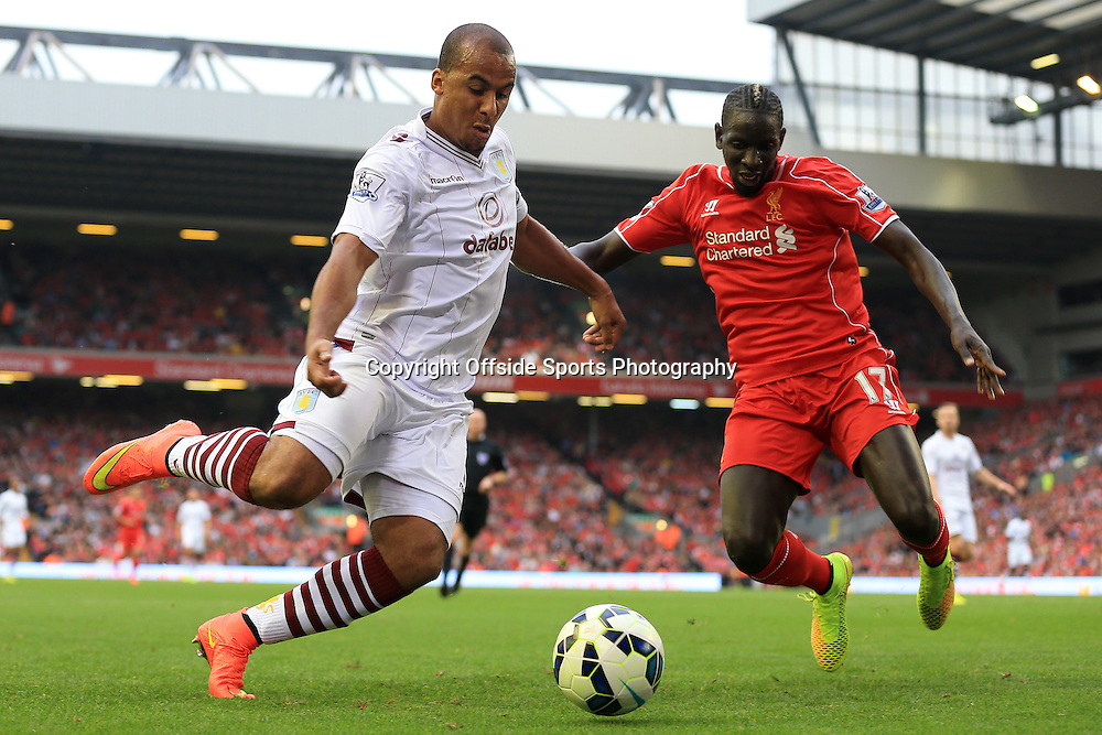 13th September 2014 - Barclays Premier League - Liverpool v Aston Villa - Gabriel Agbonlahor of Villa battles with Mamadou Sakho of Liverpool - Photo: Simon Stacpoole / Offside.