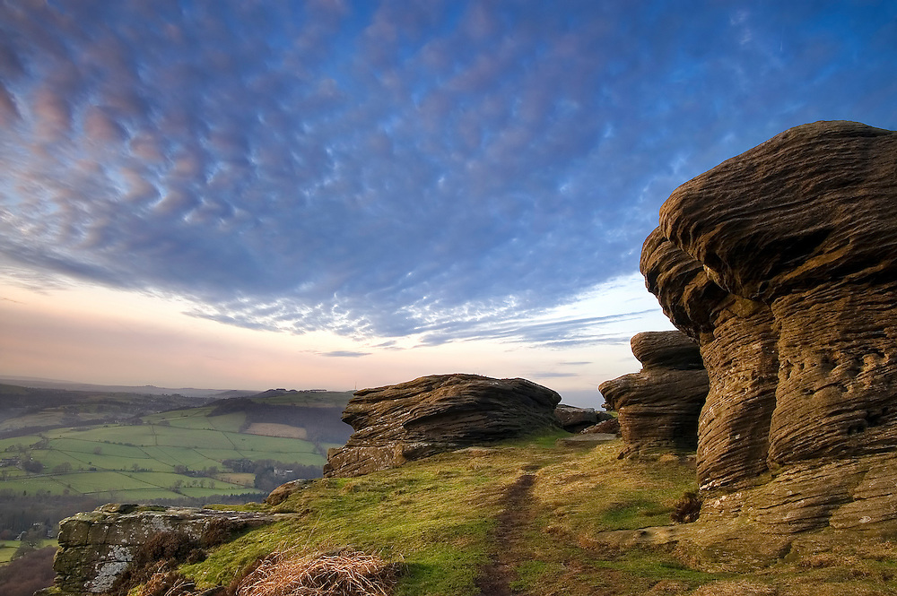 The remarkable rock formations and impressive clouds work well together to create this engaging photograph.