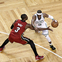 07 June 2012: Boston Celtics point guard Rajon Rondo (9) drives past Miami Heat shooting guard Dwyane Wade (3) during first half of Game 6 of the Eastern Conference Finals playoff series, Heat at Celtics at the TD Banknorth Garden, Boston, Massachusetts, USA.