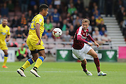 AFC Wimbledon striker Lyle Taylor (33) and Northampton Town midfielder Matthew Taylor (31) in action during the EFL Sky Bet League 1 match between Northampton Town and AFC Wimbledon at Sixfields Stadium, Northampton, England on 20 August 2016. Photo by Stuart Butcher.