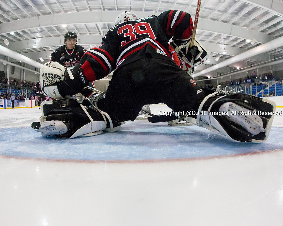 Oakville, ON - JAN 16, 2016 : Ontario Junior Hockey League game action between Milton Icehawks and Oakville Blades, Jakob Devincentis #39 of the Milton Ice Hawks attempts to make a save during the third period. <br /> (Photo by Kevin Sousa / OJHL Images)